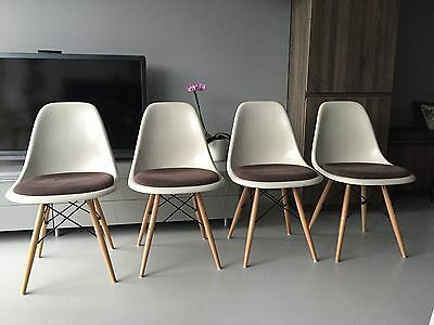 Vitra Original Charles Eames fibreglass upholstered chairs with dowel bases