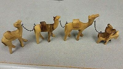 """Lot of 4 Vintage Hand Carved Wood Walking Camel Figurines 3 to 4"""" Tall"""