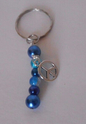 handcrafted zipper pull backpack charm blue glass beads peace sign charm