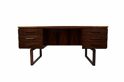 A rosewood desk by Henning Jensen and Torben Valeur