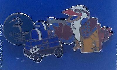 Sydney 2000 Olympic Games Badge Pin - Mascot Olly with Baggage Trolley