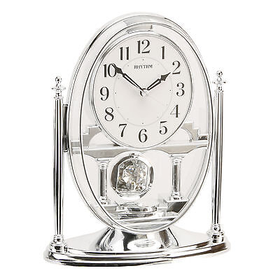 Rhythm Mantel Clock With Crystal Pendulum.new & Boxed. Choice Of Silver Or Gold
