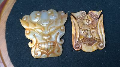 Group of Two Antique Nephrite Jade Tao-Tieh Masks.
