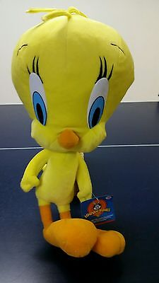 "A new Looney Tunes Tweety bird.  The size is about 19"" tall, 10"" width & 8""thick"