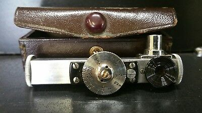 vintage minolta in leather case camera accessorie