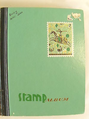 Stamp Album with at least 400 used Australian Stamps.