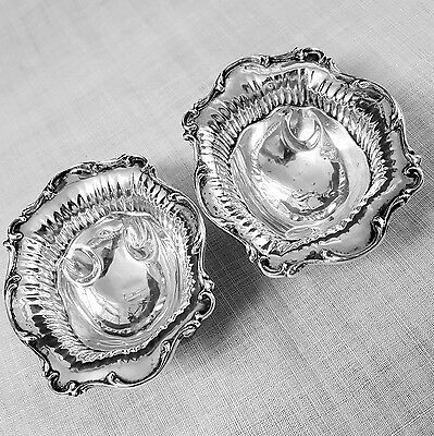 Foster & Co. pair of fancy footed nut dishes in sterling silver