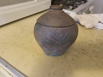Candle in pottery