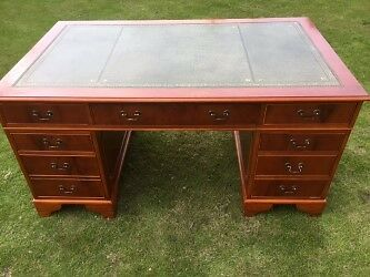 Large reproduction Yew office desk with green leather inlay