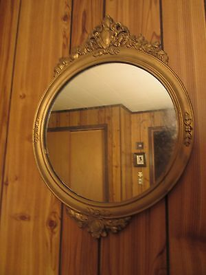 Round Antique Wood Wall Mirror With Ornate Gold Carving