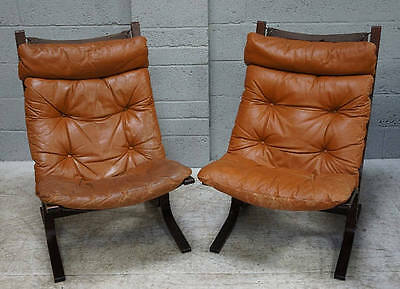 A pair of mid 20th century Scandinavian leather and bentwood easy arm chairs.