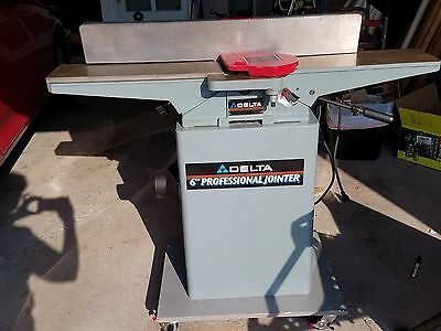 """Delta 6"""" Professional Jointer mounted on Steel Cabinet mobile base."""