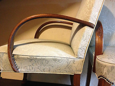 2 Blackwood Art Deco Arm Chairs With Curved Arms And Decorated Legs.