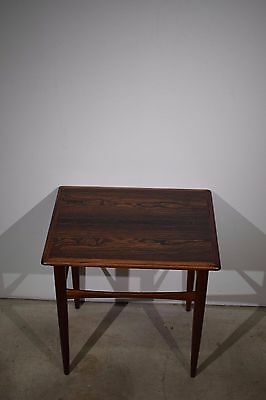 A rectangular Danish mid century rosewood side table