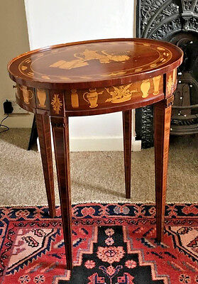 An inlaid oval side table with side drawers