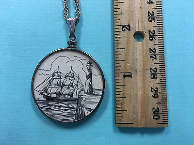 Scrimshaw Schooner Lighthouse on cliff Large Round Pendant with chain