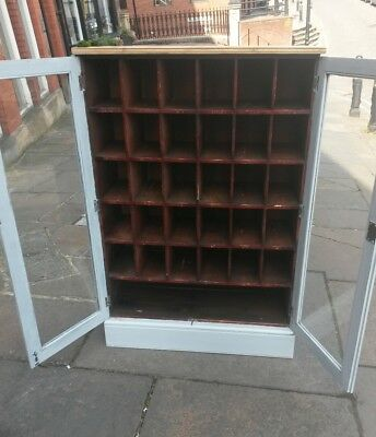 antique pigeon hole cabinet /wine cabinet  holds 30 bottles.  UK delivery  avail