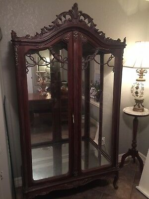 Antique Curio Cabinet hand carved with mirror back