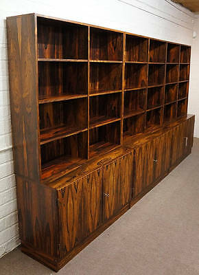 A 20th century triple section rosewood cupboard bookcase.