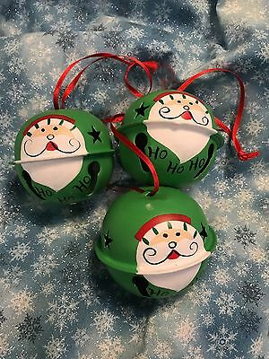 "3- 2.5"" Hand Painted Jingle Bells - Green With Santa Faces - Cutout stars"