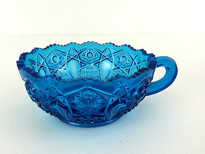 blue pressed glass nappy, nut bowl with handle 1900 - 1930's