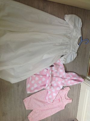 A Bundle Of Baby Girls Clothes Including A New Christening Gown