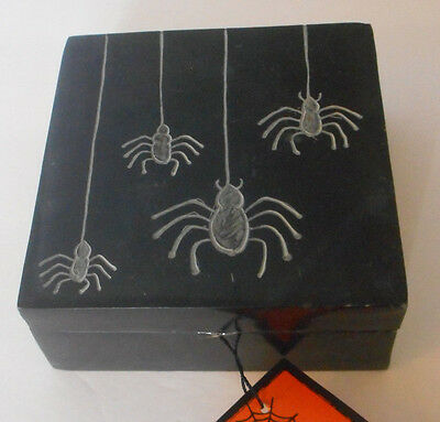 small black stone box with carved spider and web design hand crafted in India
