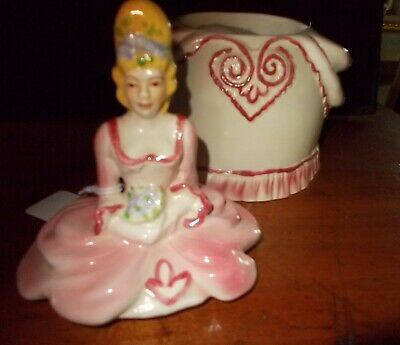 Figural powder jar with music box of colonial woman