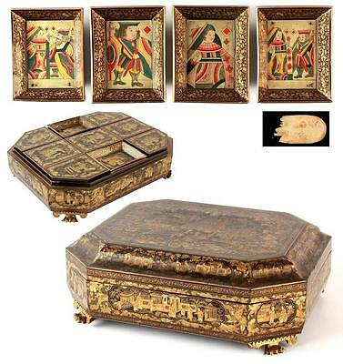 An early/mid C19th Chinese export Cantonese lacquer gaming box on paw feet