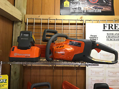 NEW Husqvarna 136Li Battery Powered CHAIN SAW W/BATTERY & CHARGER! FACTORY DLR