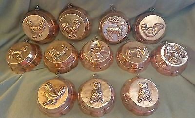 "12 Antique Copper Molds that are 4 1/4"" x 1 1/2"" H"