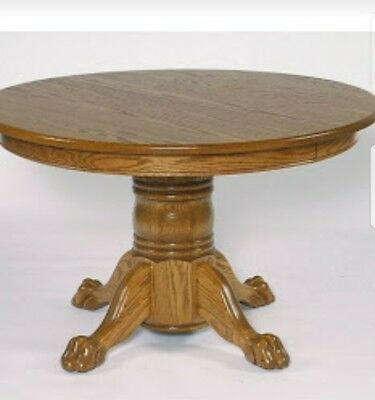 Oak lionclaw dining room table