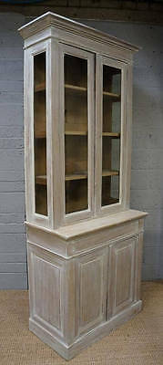 A 20th century French white painted glazed cupboard bookcase