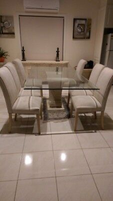 Glass Dining Table and 6 Upholstered Cream Chairs