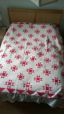 Antique red and white patch work bed spread