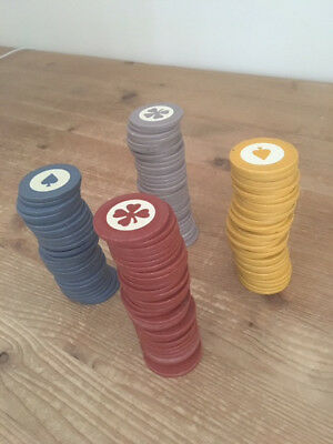 Vintage clay poker chip set of 126 marked with clover and spade in four colors