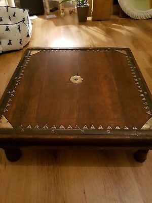 a rustic wooden table/coffee table