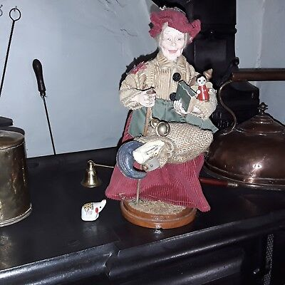 unusual  figure  of pedlar lady on wooden base