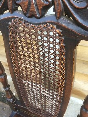 Beautifully carved Oak dining chair with cane back and leather seat