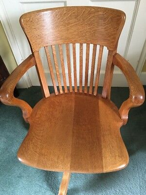 Antique oak captain's chair