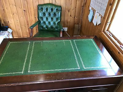 green leather top desk and captain chair
