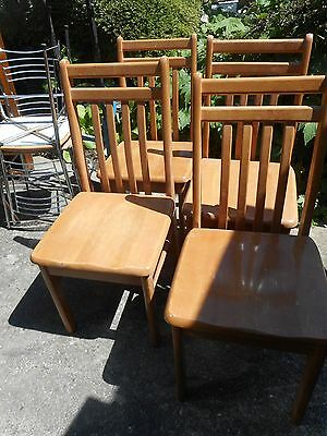 vintage set of 4 blonde solid wooden dining chairs in good used condition.