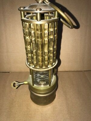 Miners mining Wolf safety lamp
