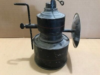 Miners mining Baldwin projector carbide lamp