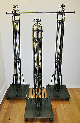 Shop Fittings: Handmade ornate steel clothing racks on wheels.