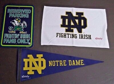 Notre Dame Pennant, Towel, and Parking Sign Lot - (3) items