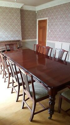 Victorian Mahogany Extending Dining Table with 10 matching chairs.