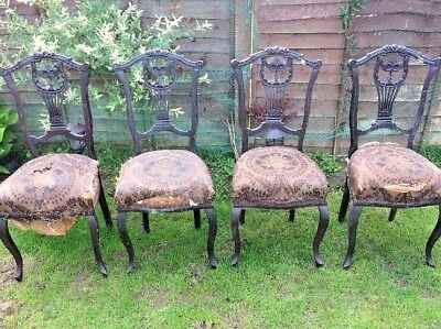 Set of four Edwardian Chippendale style ebonised dining chairs