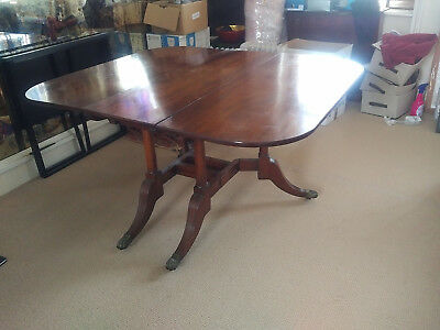 Victorian mahogany drop leaf dining table with lion claw legs and rounded edges