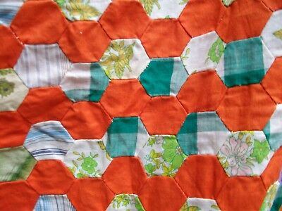 Vintage hand sewn quilt top; small cotton hexagons, mostly orange. Estate find.